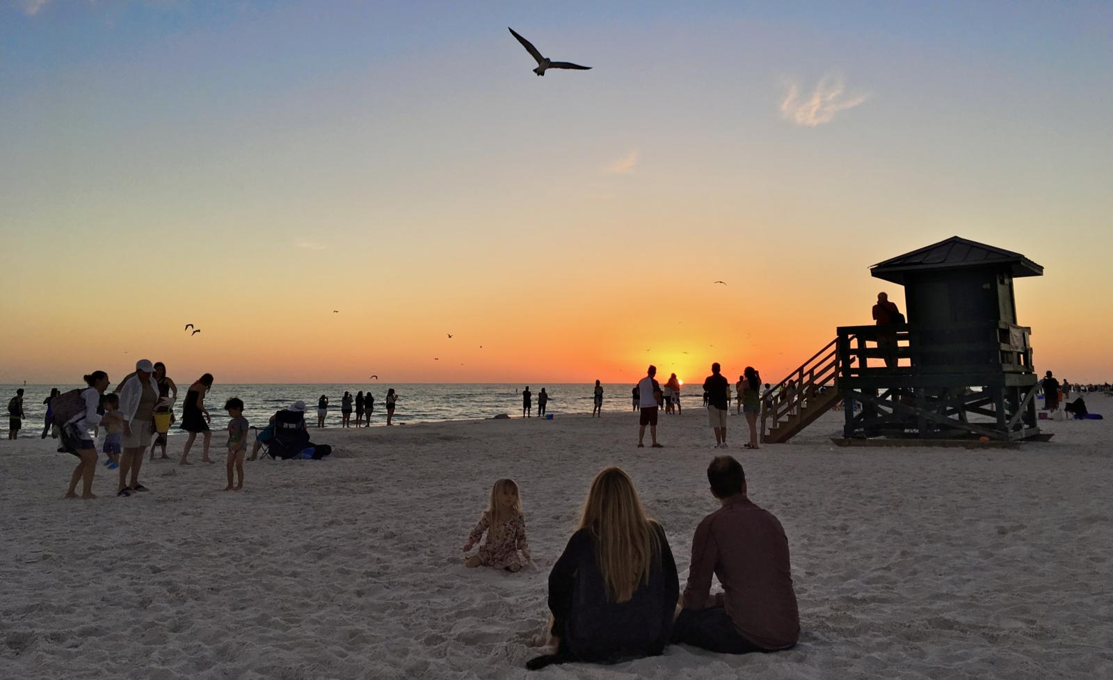 Watching the sunset on Siesta Key near Peppertree Bay