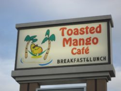 sign for the toasted mango