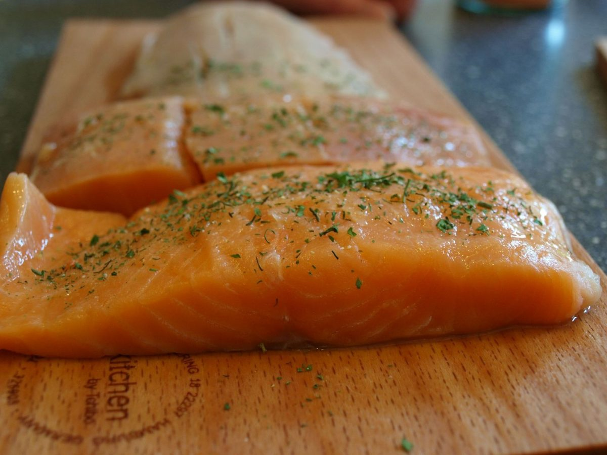 seasoned fish fillets on cutting boards