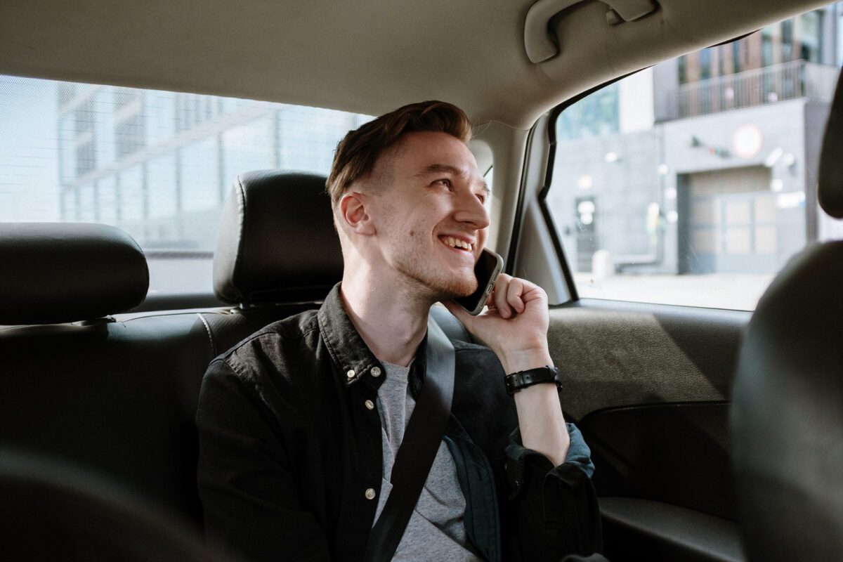 man riding in cab