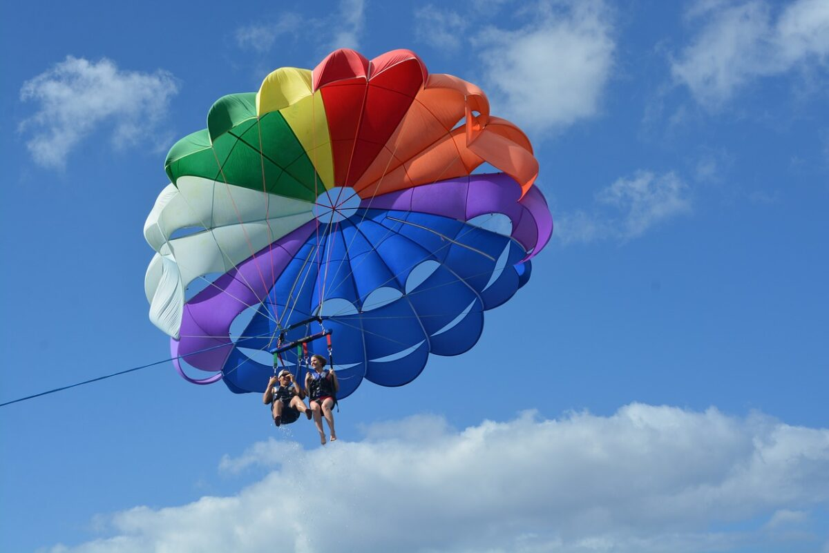 double parasailing with rainbow parachute